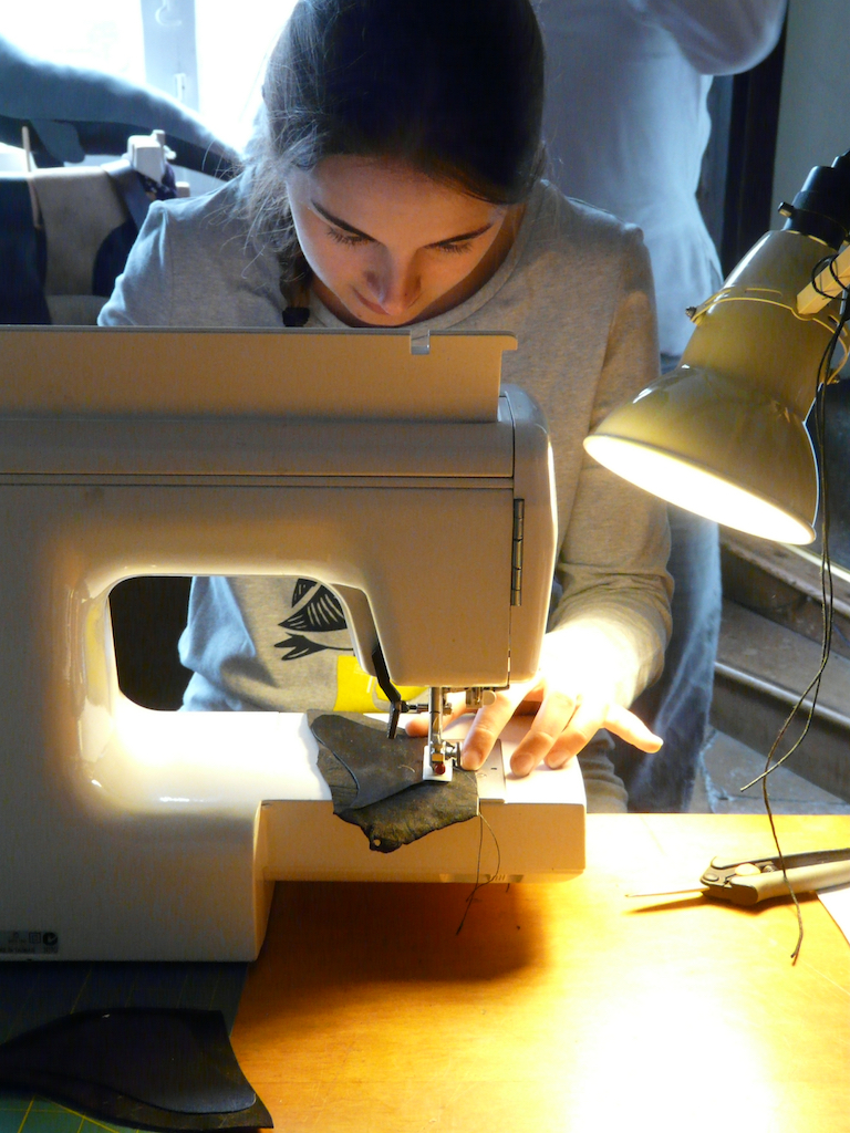 Stitching the leather whale at The Whale Whorkshop