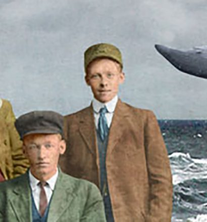 men in a boat with a whale